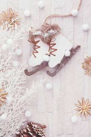 Christmas winter background. Figure skate Christmas ornament on festive background. Top view, blank space, vintage toned image Imagens