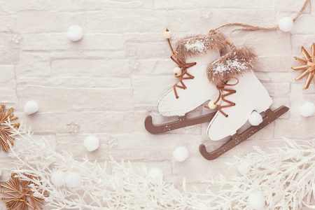 figure skate: Christmas winter background. Figure skate Christmas ornament on festive background. Top view, blank space, vintage toned image Stock Photo
