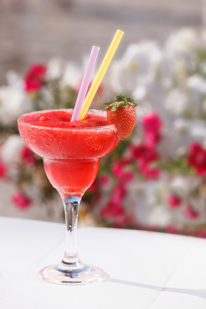 Strawberry daiquiri cocktail. Frozen Strawberry Daiquiri in glass with sugared rim and  fresh strawberry, close up