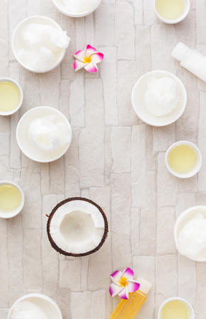 holistic view: Coconut oil. Bowls of coconut oil and fresh coconut, still life pattern background. Overhead view