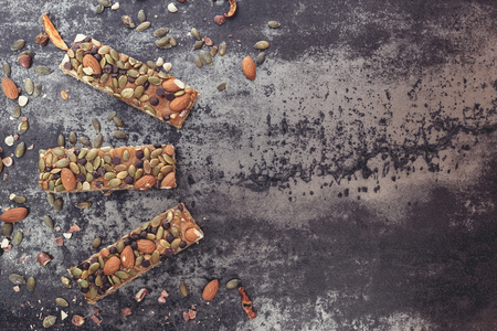 blank space: Healthy snack. Homemade granola bars with nuts and dried fruit.Top view, vintage toned image, blank space.