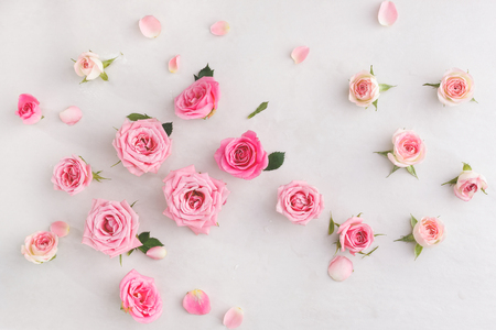 overhead view: Pastel roses background.  Various soft roses  and leaves scattered on a vintage background, overhead view
