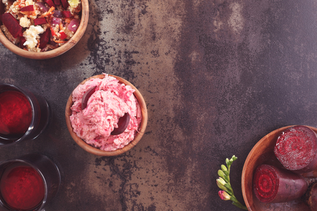 beet juice: Beetroot and yogurt dip, salad and beet juice with fresh beetroot on a dark surface. Top view, vintage toned image, blank space