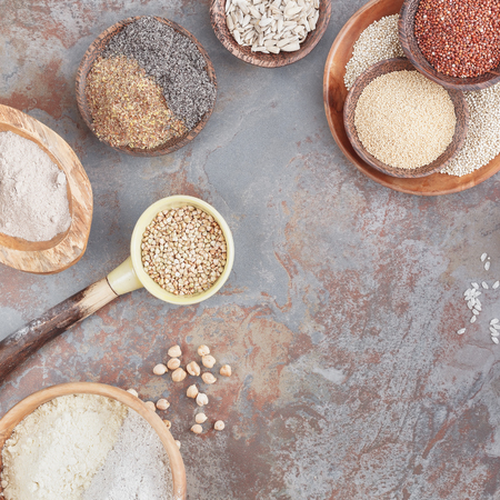 Gluten free grains and flours. A variety of gluten free ingredients, top view, blank space