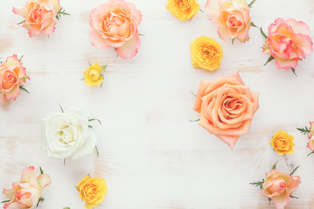 Roses on rustic wooden table. Background with fresh flowers. Top view, vintage toned image, blank space Stock Photo