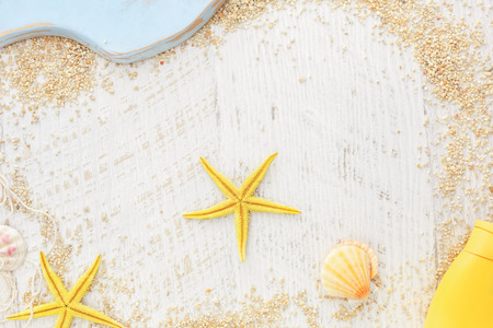 suntan lotion: Holiday beach frame. Sea shells, fishing net and  suntan lotion on a wooden background, Top view, vintage toned image, blank space Stock Photo