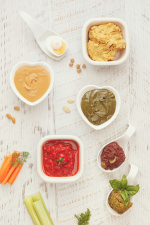 sauces: Different type of dip sauces. Various dip sauces on wooden table, top view, blank space