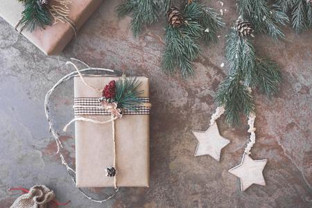 string top: Christmas gifts wrapped with string. Top view, vintage toned image, blank space
