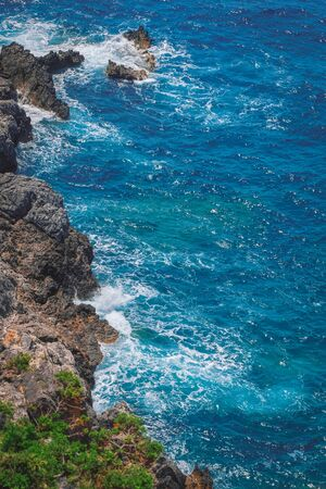 inlet bay: Rocky coastline with waves crashing, aerial view