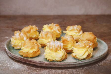 creampuff: Cream puffs with cream filling and icing sugar Stock Photo