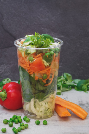 clear away: Vegetable salad in take away clear plastic cup. Selective focus, copy space