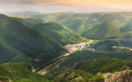 Ovcar Banja spa , view from the top of the Kablar mountain. Dramatic evening lights and shadows in springtime