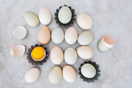 Preparing eggs. Still life of baking ingredients with organic eggs and cookie molds on rustic metal background.