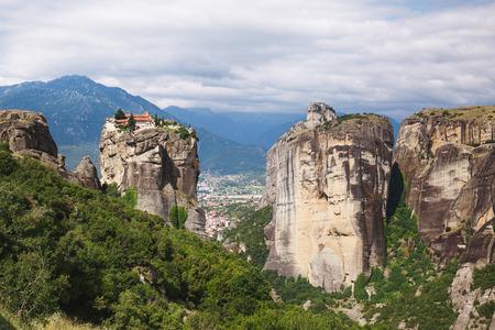 Monastery Agia Triada (Holy Trinity) at the Meteora rocks in Thessaly, - Kalambaka town  in distance, Greece