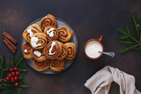 Vegan cardamom and cinnamon buns on festive table. Top view, blank space
