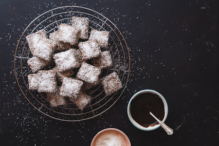 Australian Lamingtons cake. Sponge cake with chocolate glaze and grated coconut , top view Stock Photo