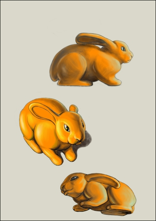 This picture shows three yellow rabbits