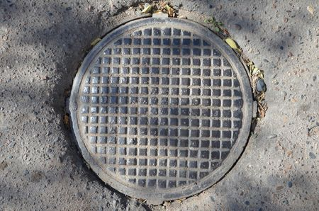 This picture shows an iron hatch with grid Stock Photo