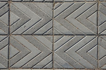 This picture shows a diagonal grid of footpath texture vertical