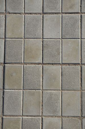 This picture shows a simple grid of footpath texture vertical