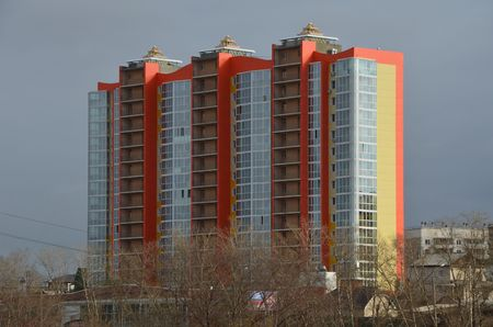 This picture shows a modern orange building isolated