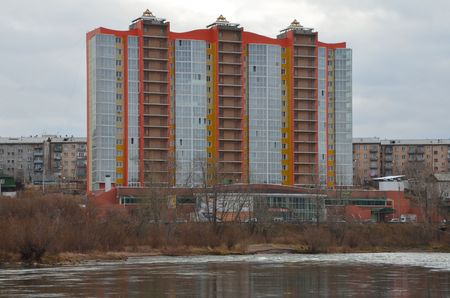 This picture shows a modern building near a riverside zoomed