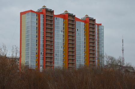 This picture shows a modern building with a television tower on background Redactioneel