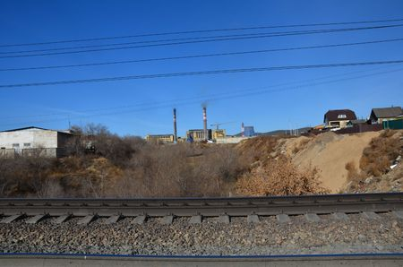 This picture shows two funnels with railroad on foreground