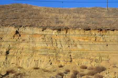 This picture shows a sandy slope with wires on foreground