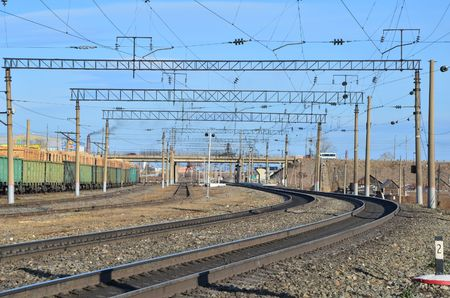 This picture shows a railway turn with bridge on background