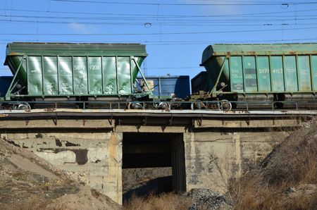 This picture shows two trains above a bridge