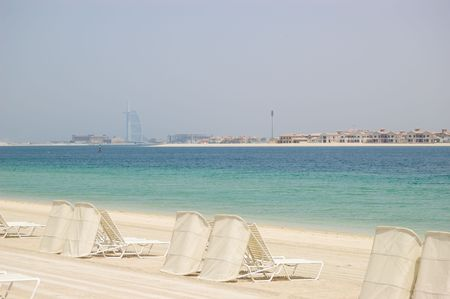 Beach of Atlantis the Palm hotel, view on Burj Dubai and villas of Jumeirah Palm frond, Dubai, UAE photo