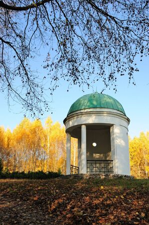 Pavilion in a park with yellow birch tree and blue sky on background, Olexandria Park, Bila Tserkva, Ukraine photo