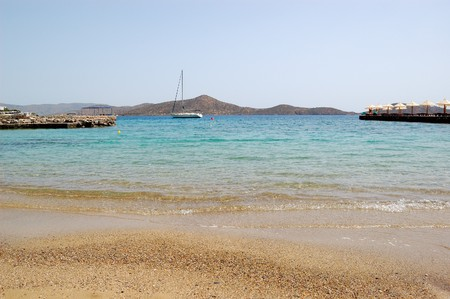 Beach  with yacht view, Crete, Greece photo