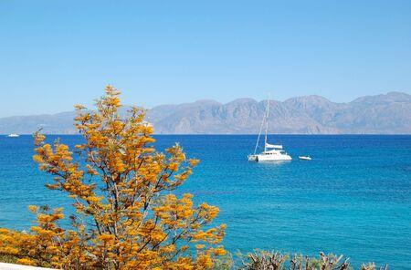 Turquoise Aegean Sea and luxury yacht, Crete, Greece photo