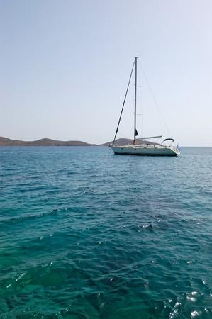 Recreation yacht and turquoise sea, Crete, Greece photo