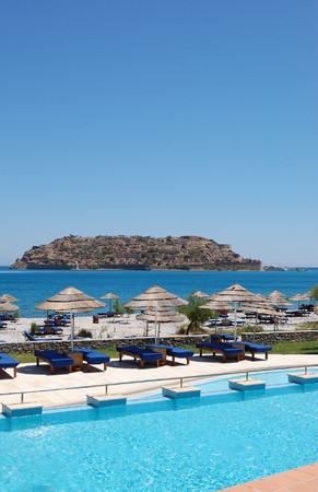 Swimming pool and beach with a view on Spinalonga Island, Crete, Greece photo