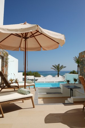 Sunbeds and swimming pool at the sea view luxury villa, Crete, Greece photo