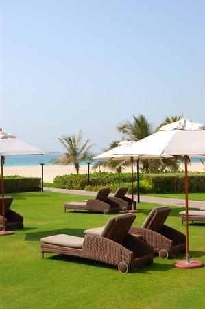 Sunbeds at the beach of luxury hotel, Dubai, UAE