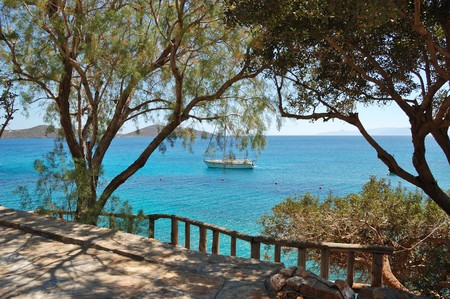 Recreation sail yacht at the beach of luxury hotel, Crete, Greece photo