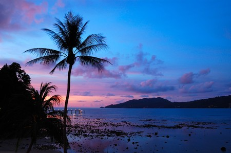 Sunset at the Patong beach,  Phuket, Thailand photo