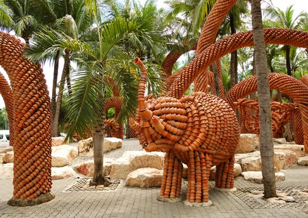 PATTAYA, THAILAND - SEPTEMBER 7: The elephant sculpture made from the pots in Nong Nooch tropical garden on September 7, 2010 in Pattaya, Thailand. More then 2000 visiters attend it daily