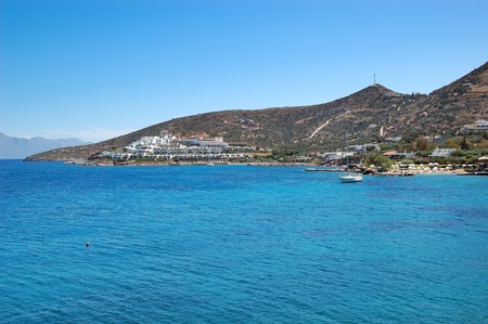 Yacht at the beach of luxury hotel, Crete, Greece photo