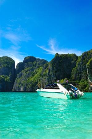 phi phi island: Motor boat on turquoise water of Maya Bay lagoon, Phi Phi island, Thailand