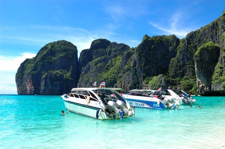 KOH PHI PHI, THAILAND - SEPTEMBER 13: Motor boats on turquoise water of Maya Bay lagoon on September 13, 2010 in Koh Phi Phi island, Thailand. Maya Bay is the major travel destionation in Thailand