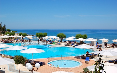 greece shoreline: CRETE, GREECE - MAY 12: Swimming pool and beach of the Terra Maris luxury hotel on May 12, 2010 in Crete island, Greece.  Approximately 15000000 tourists have visited Greece in year 2010
