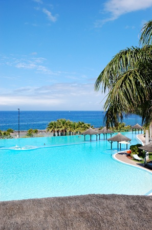 Swimming pool with jacuzzi and beach of luxury hotel, Tenerife island, Spain
