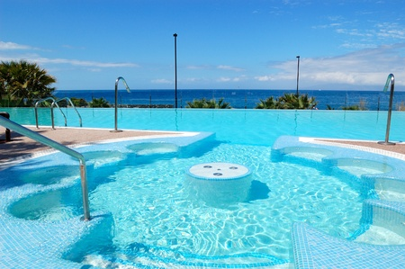 Swimming pool with jacuzzi at luxury hotel, Tenerife island, Spain