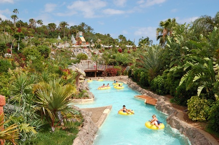 TENERIFE ISLAND, SPAIN - MAY 22: The tourists enjoying water attractions in Siam waterpark on May 22, 2011 in Tenerife, Spain. The Siam is the largest water theme park in Europe.