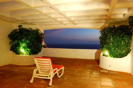 The sea view from a terrace of luxury hotel, beach and Atlantic Ocean at sunset, Tenerife island, Spain